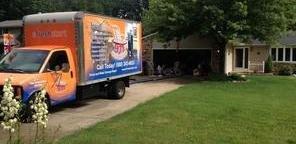Water Damage Restoration Truck Parked Near Lawn
